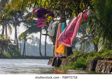 Laundry hanging over a canal near to Alleppey (Alappuzha) in Kerala, India.