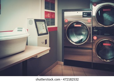 Laundry machines at laundromat shop service.