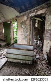 Laundry room and trolley at an abandoned and derelict lunatic asylum/hospital (now demolished), Cane Hill, Coulsdon, Surrey, England, UK