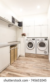 Laundry room with washing and drying machines