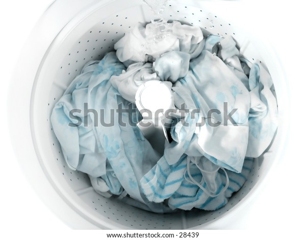 Laundry soaking in a clothes washer.