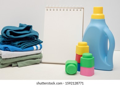 Laundry tips mock up. Detergent bottle and blank page notepad with copy space on white background.