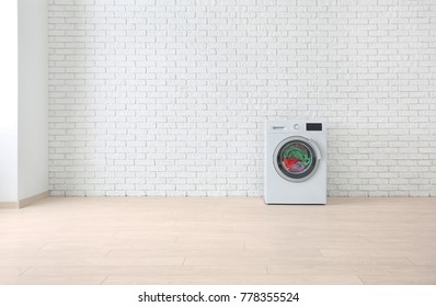 Laundry in washing machine on brick wall background