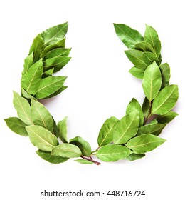 Laurel wreath made of dried branches and leaves isolated on a white background