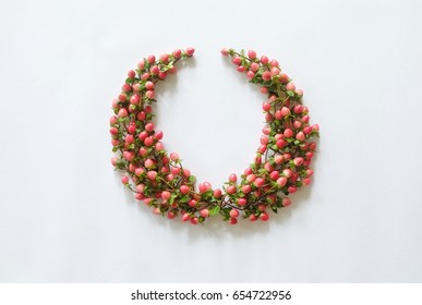 laurel wreaths made of red hypericum