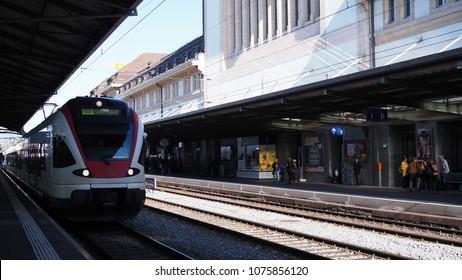 Lausanne city, Switzerland. April 4, 2018. Red express train was running on railway