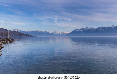 Lausanne quay of Geneva Lake and mountains in winter Lutry in Switzerland.