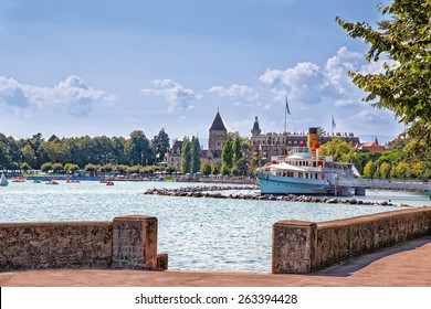 Lausanne quay of Geneva Lake in summer with steamer on the pier