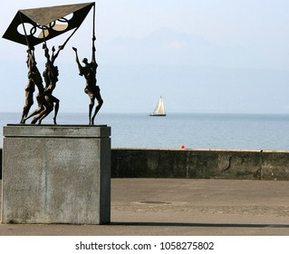 LAUSANNE, SWITZERLAND - 03 MAY, 2009: Statue in front of the Olympic Park on the shore of Lake Leman (Geneva ), in Lausanne, Switzerland, largest archive of Olympic Games in the world.