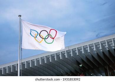 Lausanne, Switzerland - 23 June, 2019: Olympic flag flies against a gloomy blue sky