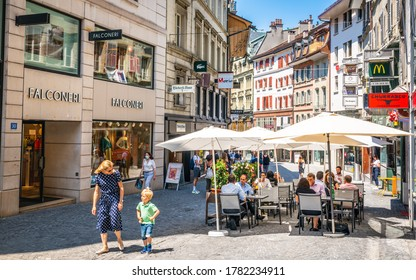 Lausanne Switzerland , 25 June 2020 : Rue de Bourg a pedestrian shopping street in old Lausanne with people on a restaurant terrace enjoying 2020 summer in Lausanne Vaud Switzerland