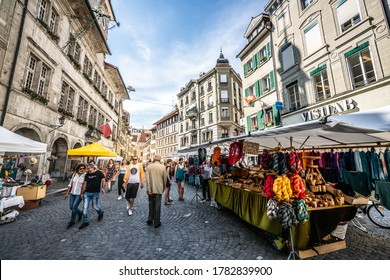 Lausanne Switzerland , 26 June 2020 : People at creative artisans market on Place de la Palud or Palud square in Lausanne Vaud Switzerland