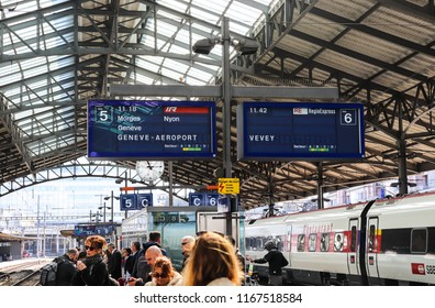 Lausanne, Switzerland - April 13 2018: Passengers are waiting to take a train in Lausanne Gare (Lausanne Station)