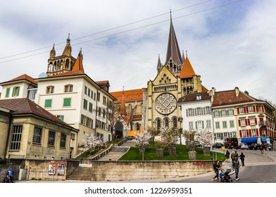 Lausanne, Switzerland - April 14 2018: People are walking around Notre Dame Cathedral in Lausanne