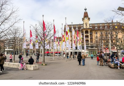 Lausanne, Switzerland - April 14 2018: People are relaxing around Port of Ouchy (Le Port d'duchy) in Lausanne
