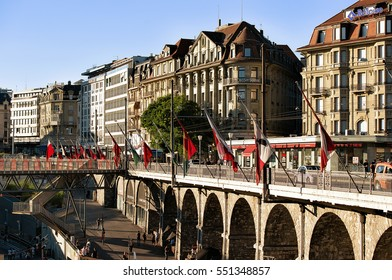 Lausanne, Switzerland - August 26, 2016: Le Flon district with the Grand pont bridge with flags in Lausanne, Switzerland. People on the background