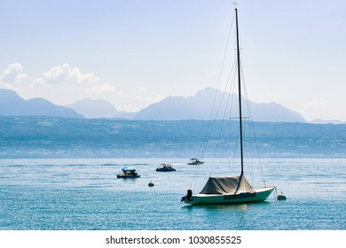 Lausanne, Switzerland - August 26, 2018: Motorboat on Lake Geneva in Lausanne, Switzerland. Alps on the background