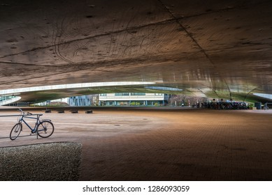 LAUSANNE, SWITZERLAND - DECEMBER 2018: Exterior ground floor of Rolex Learning Center (EPFL) in Lausanne, Switzerland with fascinate concrete undulating perforated floor and roof with glass facade.