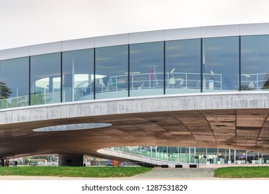 LAUSANNE, SWITZERLAND - DECEMBER 2018: Exterior view of Rolex Learning Center (EPFL) in Lausanne, Switzerland with fascinate concrete undulating perforated floor and roof with glass facade.