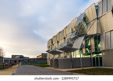 LAUSANNE, SWITZERLAND - DECEMBER 2018: Exterior view advance zigzag facade of ArtLab EPFL, Art center, at Swiss Federal Institute of Technology Lausanne, Lausanne, Switzerland with cloudy sunset sky.