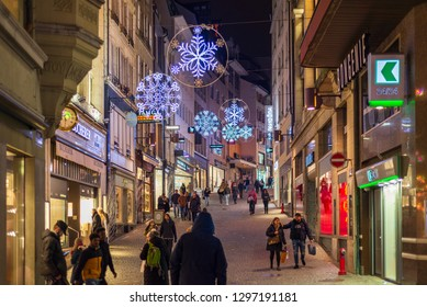 Lausanne, Switzerland - DECEMBER 2018: Night illuminated scenery of promenade shopping district around Place de la Palud inside old town with decorated Christmas 's light in Lausanne, Switzerland.