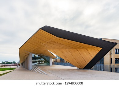Lausanne, Switzerland - DECEMBER 2018: View of contemporary architecture cover walkway with cool black and wood  facade and ceiling at Swiss Federal Institute of Technology Lausanne, Switzerland.