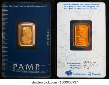 Lausanne / Switzerland - January 31, 2019: 24 carat gold ingot for safe investment. Melted in PAMP refinery.