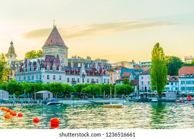 LAUSANNE,  SWITZERLAND, JULY 18, 2017: Sunset view of the Chateau d'Ouchy hotel at Lausanne, Switzerland
