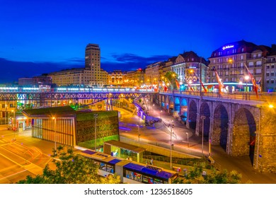 LAUSANNE,  SWITZERLAND, JULY 18, 2017: Night view of the Bel-air tower viewed over the Flon square in Lausanne, Switzerland
