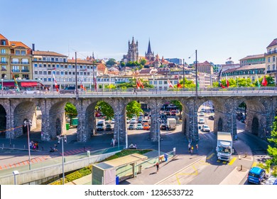 LAUSANNE,  SWITZERLAND, JULY 19, 2017: Cathedral of our lady viewed behind the Grand Pont in Lausanne, Switzerland