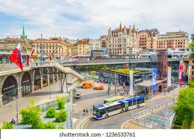 LAUSANNE,  SWITZERLAND, JULY 19, 2017: View of traffic on the Flon square in Lausanne, Switzerland