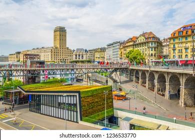 LAUSANNE,  SWITZERLAND, JULY 19, 2017: Bel-air tower viewed over the Flon square in Lausanne, Switzerland
