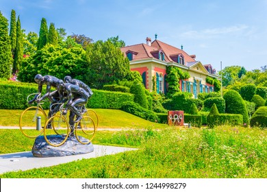 LAUSANNE, SWITZERLAND, JULY 19, 2017:Statue of cyclists in front of the international olympic museum in Lausanne, Switzerland