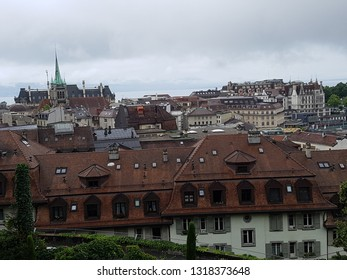Lausanne, Switzerland - July 2 2017: Aerial top view the street of old town in Lausanne, Switzerland with background of cloudy overcast sky and skyline over Geneva lake from Lausanne Cathedral