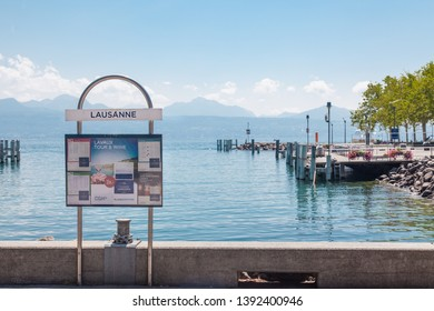 Lausanne, Switzerland - July 29 2018: Information sign and ship timetable at pier in Lausanne Ouchy port on Lake Leman (Geneva Lake) on sunny summer day