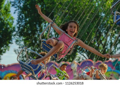 Lausanne, Switzerland - JUN 02, 2012 : Yearly fair in Ouchy Lausanne. Children are happy in the carousel