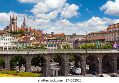 LAUSANNE, SWITZERLAND - JUNE, 20: 2012: View of Grand-Pont Bridge and Notre-Dame Cathedral of Lausanne.