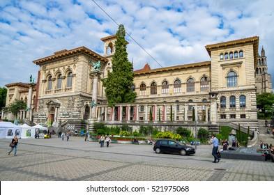 LAUSANNE, SWITZERLAND - JUNE 9, 2011: Everyday life on Place de la Riponne near Palais de Rumine in the center of Lausanne