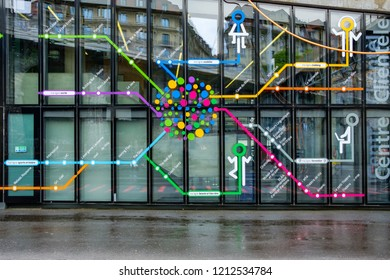 LAUSANNE, SWITZERLAND - MAI 23, 2018 : Colorful and artistic map of the subway lines in Lausanne drawn on the window of the entrance of a metro station in Lausanne, Switzerland.