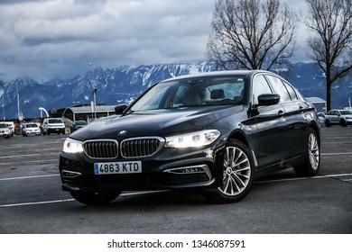 Lausanne, Switzerland - March 11, 2019: Black motor car BMW 520d (G30) in the city street.
