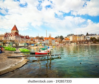 LAUSANNE, SWITZERLAND - MARCH 18th: People on the lakeside of Lausanne on July 17, 2012 in Lausanne, Switzerland. View to Place du Port square with Chateau d'Ouchy.