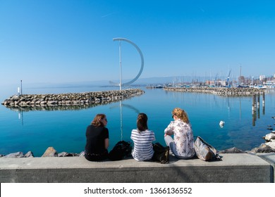 Lausanne, Switzerland - March 24, 2019: Tourism view at Geneva lake with scenery of embankment Eole Sculptural landmark and background of pier in Lausanne, Switzerland