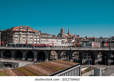 Lausanne, Switzerland - March 24, 2019 : Place de l'Europe or Europe square top view with bus and Flon district subway station entrance in Lausanne Switzerland