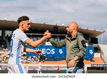 LAUSANNE, SWITZERLAND - MAY 26, 2019: FC Lausanne-Sport player, Andi Zeqiri, with the manager, Giorgio Contini.