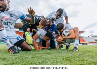 LAUSANNE, SWITZERLAND - MAY 26, 2019: FC Lausanne-Sport players wait for the end of the match between Aarau and Rapperswil on the stadiums field.