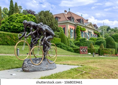 LAUSANNE, SWITZERLAND - May 31, 2017: Cyclistes sculpture at Olympic museum in Lausanne, Switzerland.