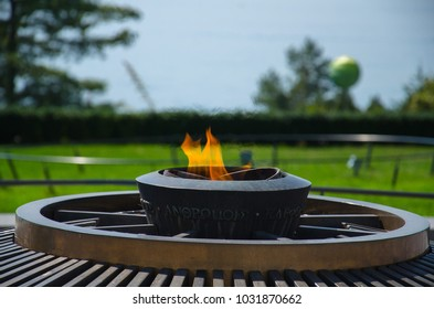 Lausanne, Switzerland - September 14, 2016: The Olympic Flame in Olympic Park in Lausanne, on the shore of the Lake Leman (Lake Geneva) near Olympic Museum, Swiss Riviera, Switzerland