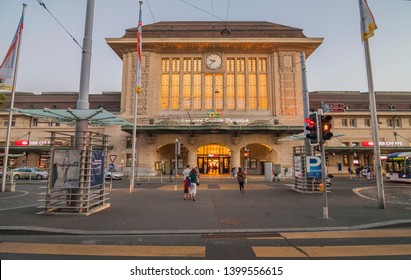 LAUSANNE, VAUD / SWITZERLAND - JULY 17, 2012: The massive art deco building of main Lausanne railway staition with clock and entrance arches on Station square (or place de la gare)