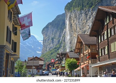 Lauterbrunnen - August 22, 2013: view of Lauterbrunnen town with the Staubbach Falls. The town is a popular tourist attraction and gateway to the Jungfrau.