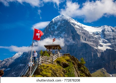 Lauterbrunnen, Switzerland - 9/7/2014: A viewpoint along the Eiger trail and The Eiger, a 3,967-metre (13,015 ft) mountain of the Bernese Alps, overlooking Grindelwald and Lauterbrunnen.